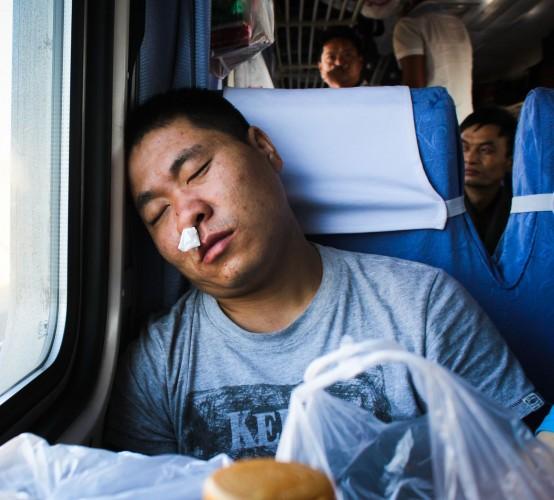 Passager au nez qui coule train Urumqi - Xi'an
